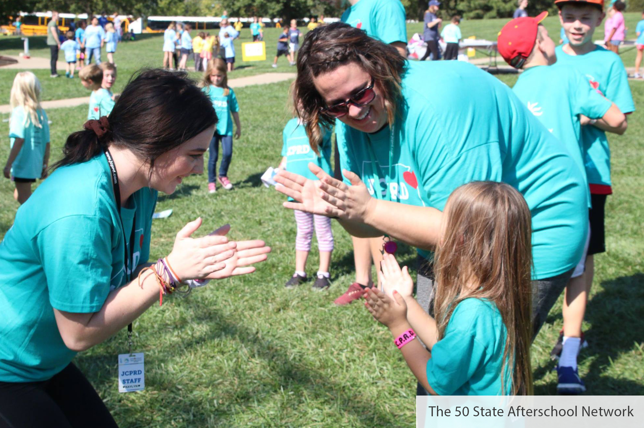 Teachers talking with child